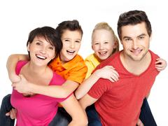 Happy family with two children on white Stock Photos