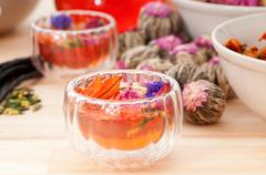 herbal natural floral tea infusion with dry flowers - stock photo