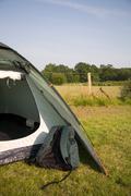 Rucksack and tent Stock Photos