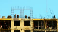 workers - builders do a frame for the concrete house - stock footage