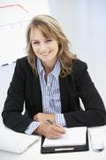 Mid age businesswoman at work - stock photo