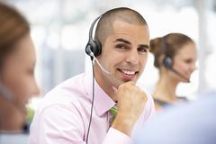 Young businessman wearing headset Stock Photos
