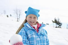 7 year old girl on winter vacation - stock photo