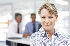 Mid age businesswoman - stock photo