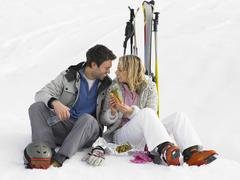 Young couple with picnic on ski vacation Stock Photos
