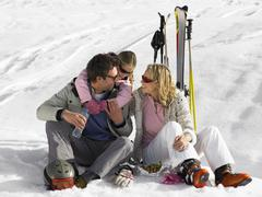 Stock Photo of young family on ski vacation