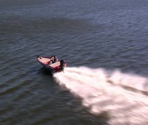 Aerial shot of speed boat from above Stock Footage
