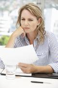 Worried businesswoman - stock photo