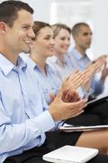 Group applauding business presentation - stock photo