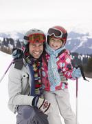 Young father and daughter on ski vacation Stock Photos