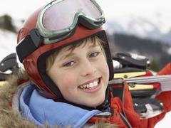 pre-teen boy on ski vacation - stock photo