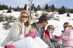 Young family on ski vacation Stock Photos