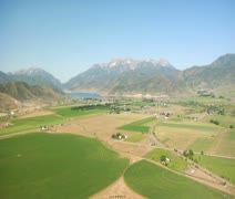 Aerial shot of mountain farming community Stock Footage