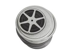 Tall stack of vintage film cans with a reel on top. Stock Photos