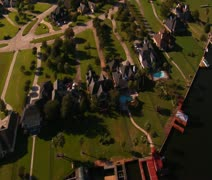 Aerial shot of lavish lakefront houses Stock Footage