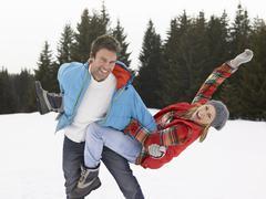 young woman  in alpine snow scene - stock photo