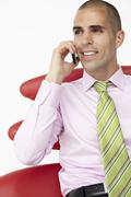 Young businessman using cellphone - stock photo