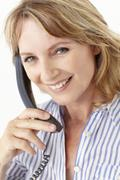 Mid age businesswoman on phone Stock Photos