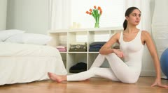 Young Caucasian woman stretching in her bedroom Stock Footage