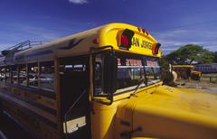 Bus traffic yellow in nicaragua san jorge Stock Photos