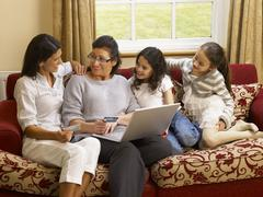 hispanic family shopping online - stock photo