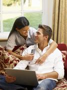Young hispanic couple shopping online Stock Photos