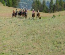 aerial shot of cowboys on mountaintop - stock footage