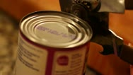 Stock Video Footage of opening can of beans