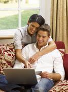 Young hispanic couple shopping online Stock Photos