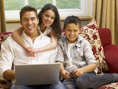 Hispanic father and children shopping online Stock Photos