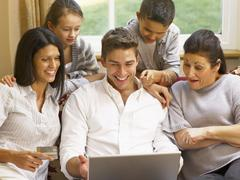 hispanic family shopping online - stock photo