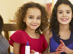 young mixed race children doing handicrafts - stock photo