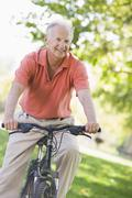 Senior man on a bicycle - stock photo