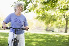Senior woman on a bicycle - stock photo