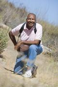 Senior man on a walking trail - stock photo