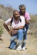 Senior couple on a walking trail - stock photo