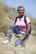 Senior woman on a walking trail - stock photo