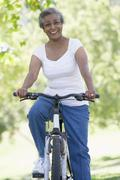 Senior woman on a bicycle - stock photo