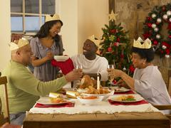 adult african american family having christmas dinner - stock photo