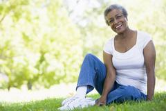 Senior woman resting in a park - stock photo