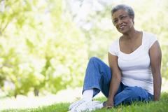 Senior woman resting in a park Stock Photos