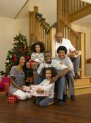 african american family with christmas tree and gifts - stock photo