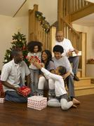 african american family exchanging christmas gifts - stock photo