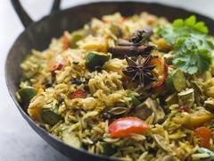 Vegetable Biryani in a Large Karahi - stock photo