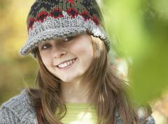 Head and shoulders of young girl in autumn woodland Stock Photos
