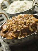 Dish of Dopiaza Veal with Fragrant Pilau Rice - stock photo