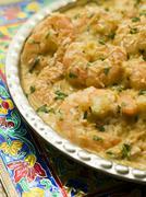 Dish of King Prawn Pasanda - stock photo
