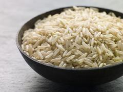 Bowl of Uncooked Basmati Rice - stock photo