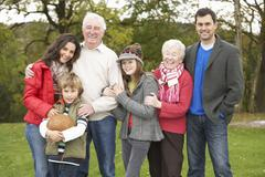 Stock Photo of extended family group on walk through countryside