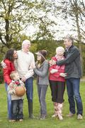 Extended family group on walk through countryside Stock Photos